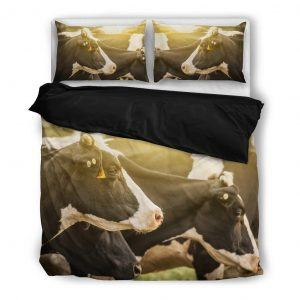 herd of cows in sunset bedding set black